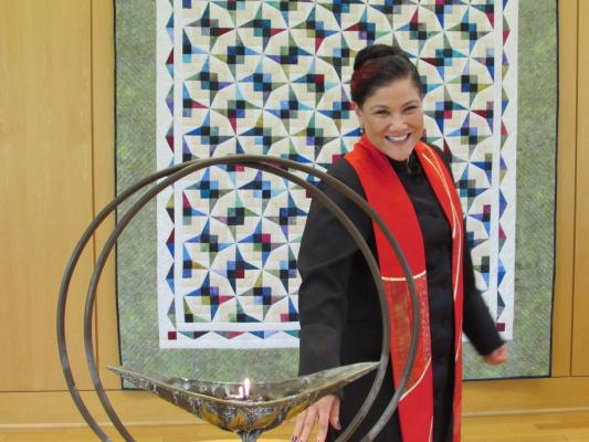 The Rev. Rebekah A. Savage with UUCR chalice.